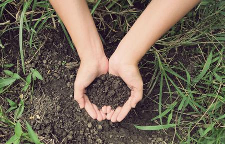Vintage Style,Soil- handful,female hands, humus soil Standard-Bild