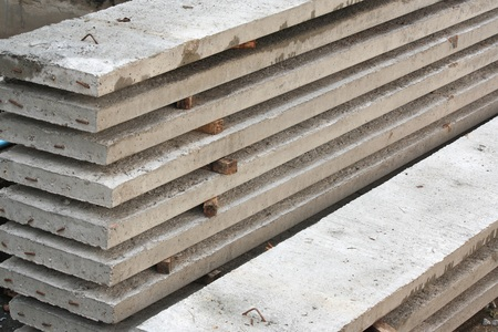 structuring: Cement sheet on the ground of construction site. Stock Photo