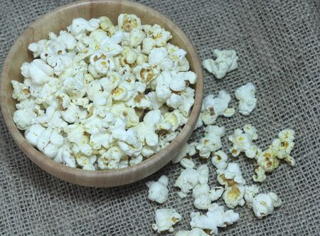 popcorn bowls: Fresh popcorn in bowl on white wooden table. Selective focus