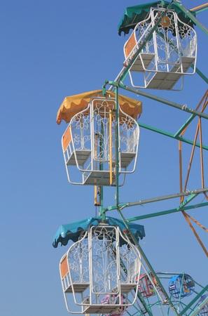 local festivals: Samut Prakan, THAILAND - October 25, 2015: Colorful Ferris wheel with blue sky in amusement park. Editorial