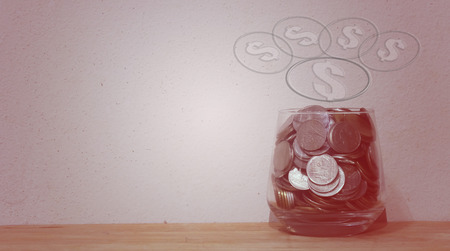 money jar: Coins in glass money jar  with a backdrop of old wall that says save , Vintage Style
