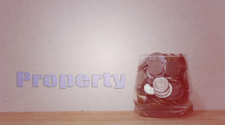 putting money in pocket: Jar with full of coins whit Vintage Style
