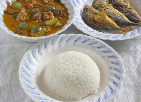 plating: Thai cuisine, Cooked rice and Green chicken Curry with fried Mackerel