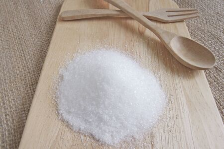 white sugar on wood plate, soft focus