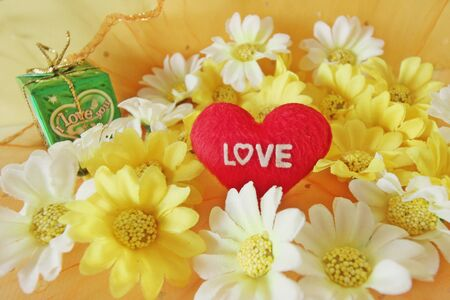 love hearts: Valentines day concept with letters love and flowers on vintage background, soft focus