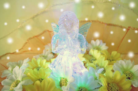 christmas concept: Christmas concept with angel statue and color light.