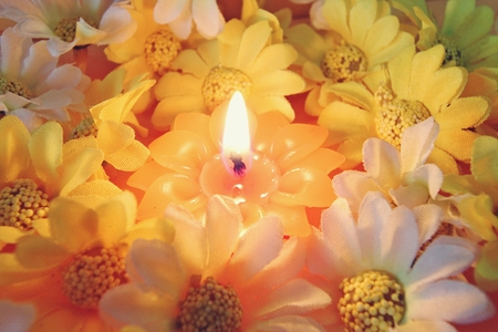 christmas concept: candlelight with flower vintage background, soft focus Stock Photo