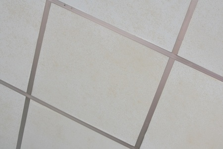 suspended: Old Texture of white panels for suspended ceiling. Stock Photo