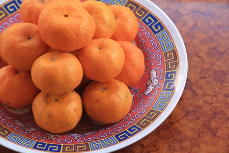 prosperous: Orange fruit, fruit auspicious for Chinese.