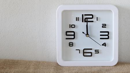 12 o'clock: Alarm clock on wood table ( alarm clock show 12 o`clock )