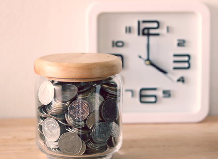 behind the scenes: The concept of saving money , a clock is behind the scenes  with filter effect retro vintage style