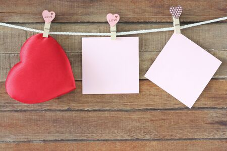 love concept, note paper on wooden background
