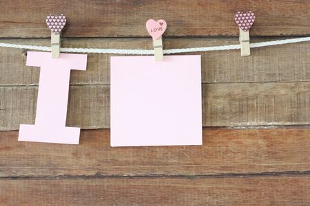i pad: love concept, note paper on wooden background