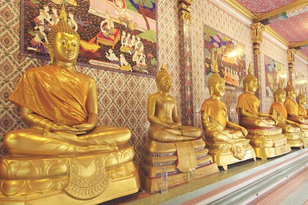 venerable: Gold Buddha at temple in Thailand, Vintage filter