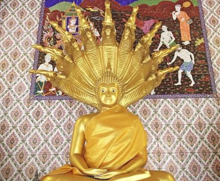 clothed: Samut Prakan- Thailand : 24 JAN 2016  Gold Buddha statues and clothed in yellow robe at Wat Bang Phli Yai Nai. Editorial