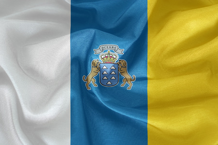 foreign country: Canary Islands flag pattern on the fabric texture