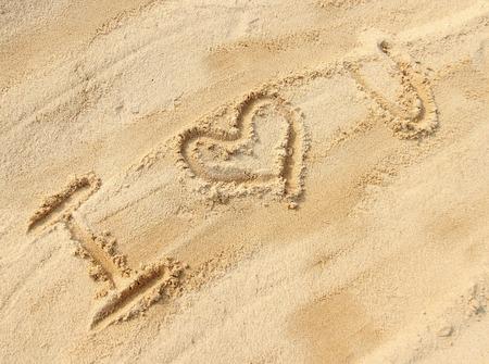sand writing: I love you - sand writing on the beach