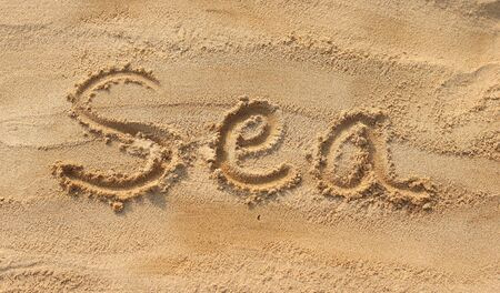 sand writing: Sea - sand writing on the beach Stock Photo