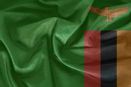 zambia flag: Zambia flag pattern on the fabric texture Stock Photo