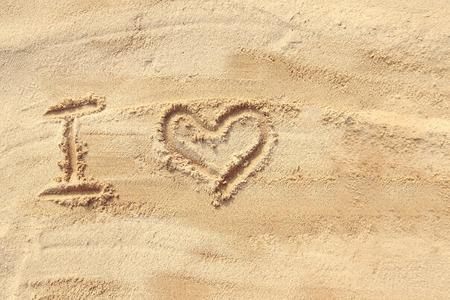 sand writing: I love - sand writing on the beach Stock Photo