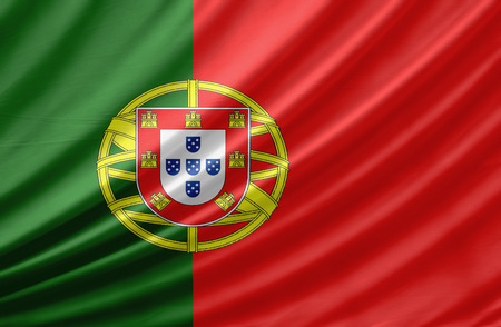 portugal flag: Waving flag of Portugal. Flag has real fabric texture Stock Photo