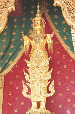 wat arun: Bangkok- Thailand : March 4, 2016  deity statue in front of the church at Wat Arun