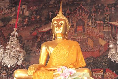 wat arun: Bangkok- Thailand : March 4, 2016  Gold Buddha statues and clothed in yellow robe at Wat Arun