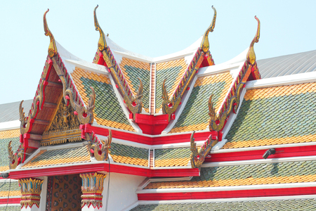 no name: colorful roof tiles and gold gable apex architecture in thailand temple. In Thailand public domain or treasure of Buddhism. no copyright and no name of artist appear.