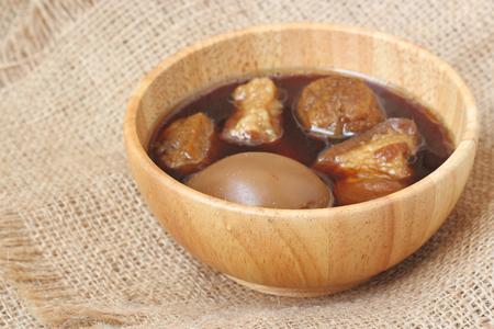 seasonings: Thai food called Pa-lo, egg and pork stew with seasonings blend sweet taste and brown sauce in wood bowl