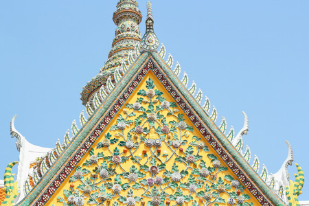 apex: Old floral, ceramic tile patterns of gable apex architecture in thailand temple. In Thailand public domain or treasure of Buddhism. no copyright and no name of artist appear. Stock Photo