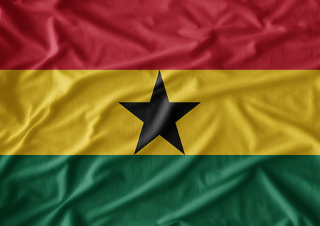 has: Waving flag of Ghana. Flag has real fabric texture