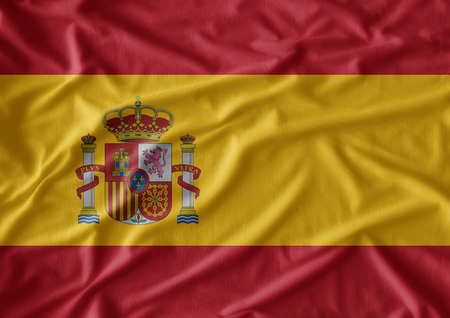 has: Waving flag of Spain. Flag has real fabric texture