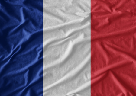 Waving flag of France. Flag has real fabric texture Stock Photo