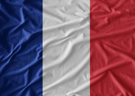 Waving flag of France. Flag has real fabric texture Standard-Bild