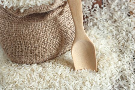 uncooked: White uncooked rice on wood table