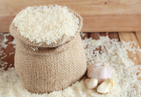 uncooked: White uncooked rice in small burlap sack