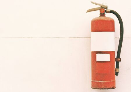 foam safe: Old fire extinguisher tank on cement wall Stock Photo