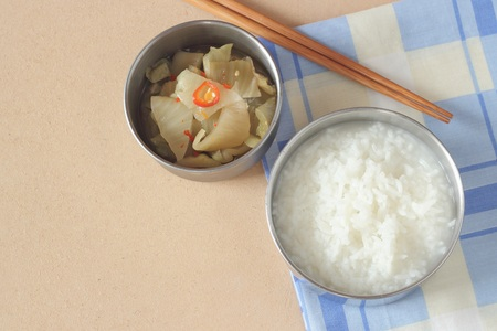 mush: mush or Boiled rice with pickled vegetables. Stock Photo