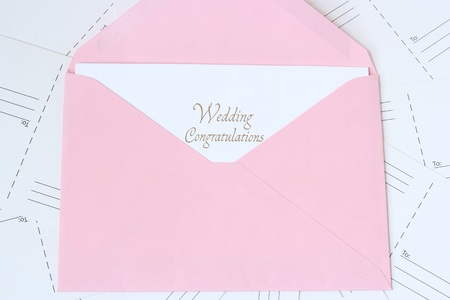 open envelope: open envelope with Congratulations card on postcards background Stock Photo