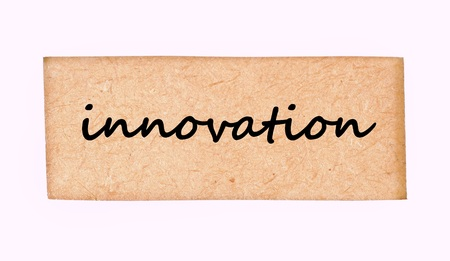 innovation word: Innovation word on wood frame texture Stock Photo