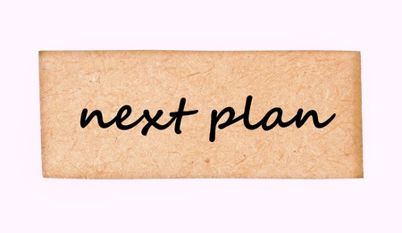 jumbled: next plan word on wood frame texture