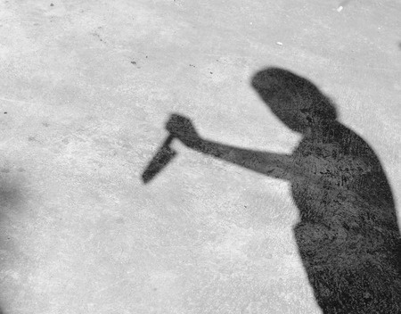 clutching: A shadow on the wall, clutching the knife