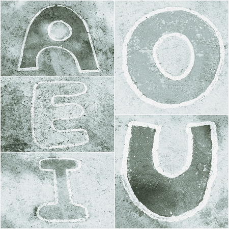 e u: old word  A, E, I, O, U  sign on cement background, black and white tone, abstract background Stock Photo