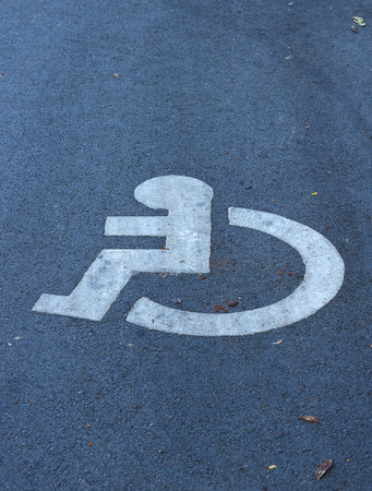 challenged: Handicap sign in public park Stock Photo