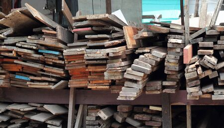 old furniture: Wood Pile. Stack of old wooden bars. Stacked wood pine timber for furniture production and construction Stock Photo