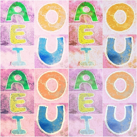e u: old word  A, E, I, O, U  sign on cement background, Vintage retro tone, abstract background