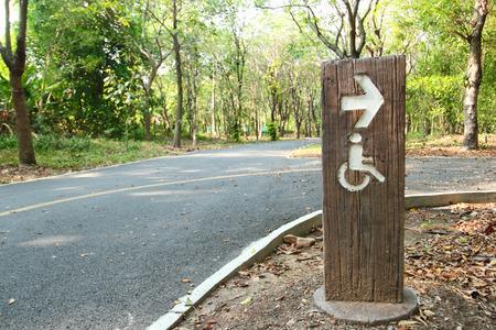Handicap sign in public park Stock Photo