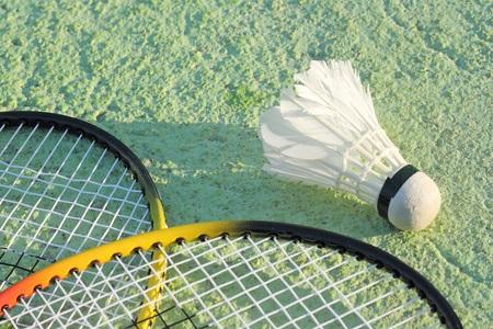 shuttlecock: badminton racket and old shuttlecock