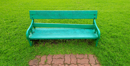 metal garden chair on green grass Stock Photo