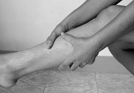 orthopedist: Stretching woman leg, pain in the calf